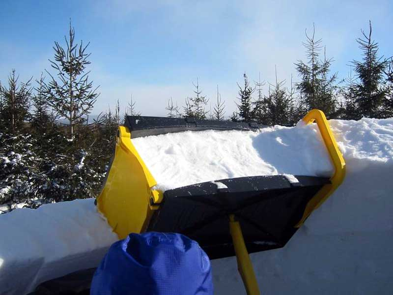 Up close view of placing a snow block on an igloo.